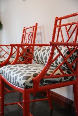red bamboo chairs with gray trellis fabric