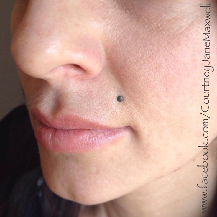 Healed monroe upper lip piercing with a matte textured for Beauty mark tattoo