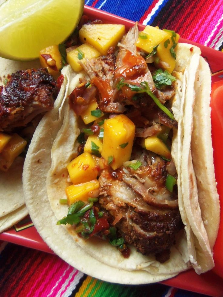 Slow Cooked Pork Rib Tacos With Mango Salsa - Hispanic Kitchen...will need to have a go at adapting this recipe as may not be able to find Mexican ingredients here. Looks very yum tho...chilli ribs!