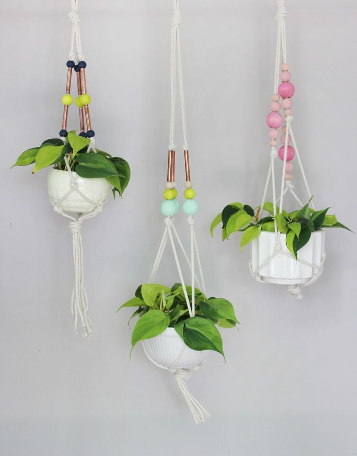 There may be more hanging planter DIYs on the Internet than any other popular craft right now, but there is always a way to take your standard craft up a notch! Why not add oversized, hand-painted, wooden beads and copper pipe accents for a little more fun! Make a trio of coordinating hangers, and enjoy both cleaner air and a cuter house. You're welcome. Supplies: -three plants inserted directly into...