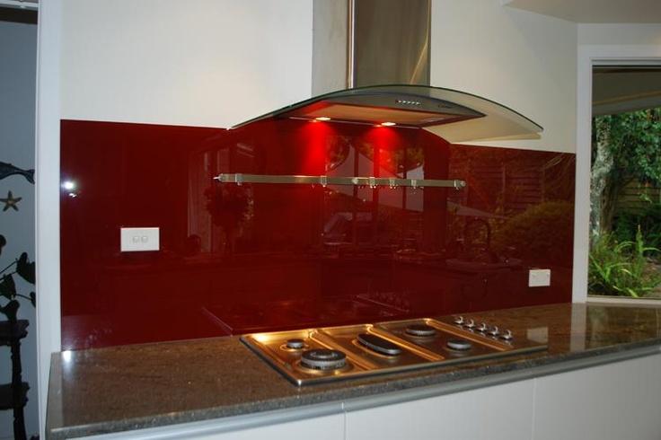 red splashback, dark grey bench and light grey cupboards