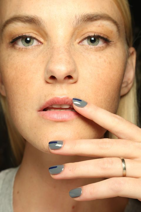 Jin Soon drew a thin navy stripe over Sally Hansen's Concrete Jungle.
