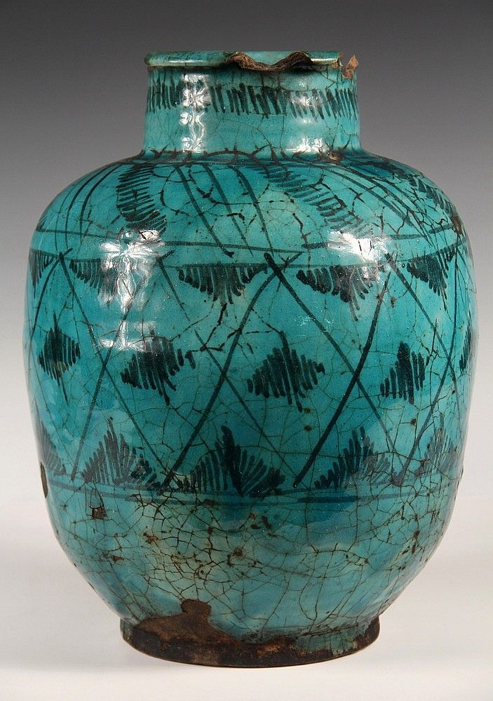 PERSIAN POTTERY - 17th-18th c. Persian Pot in aqua - by Thomaston Place Auction GalleriesPERSIAN RUG - 4' x 6 1/2' - Northeast Persia, Iran, mid 20th c, rare pictoral landscape design depicting the 'secular' period of Islam before the rise of Islam's Fundamentalism, snow capped mountains with cypress trees in ivory, tan and medium blue, overlooking an urban scene with a mosque, vehicles and planes, meandering rosette border. Good condition.