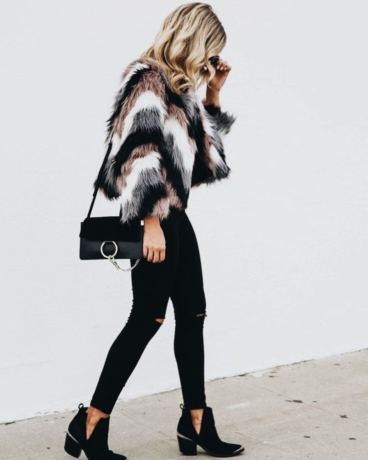 Cute faux fur jacket with all black.