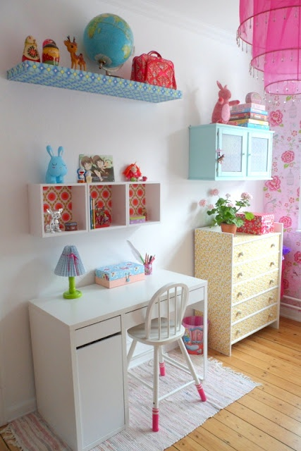 Was thinking of painting our maple lack shelf white but I could paper it like this or paint it a bright colour, too. Cute!