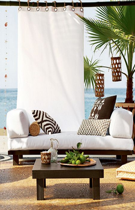 Nice outdoor living space with use of privacy curtain:). What a view!