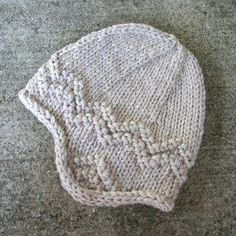 """Here's a free pattern for a super-quick, adult-sized earflap hat I made for my winter beach hikes. I used wonderfully soft and warm Dale Hubro 100% pure new wool. It's """"bulky…"""