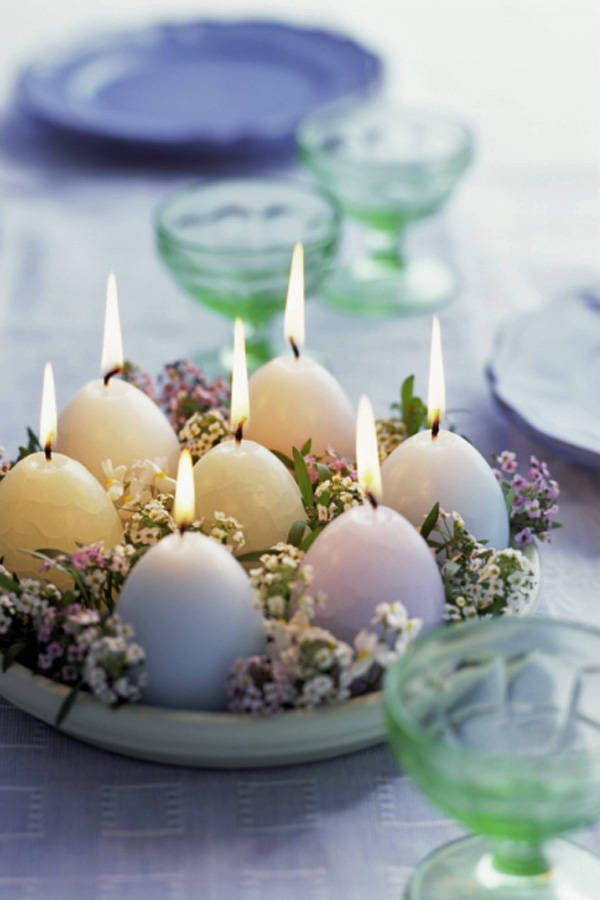 Egg-shaped candles can be found at the dollar store, combined with a simple planter tray and a few flowers