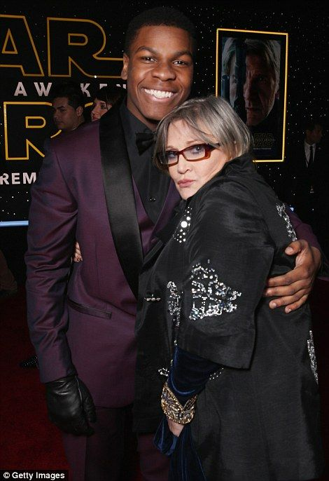 John Boyega and Carrie Fisher attend Star Wars: Force Awakens premiere. They deserve a bow... they were great!