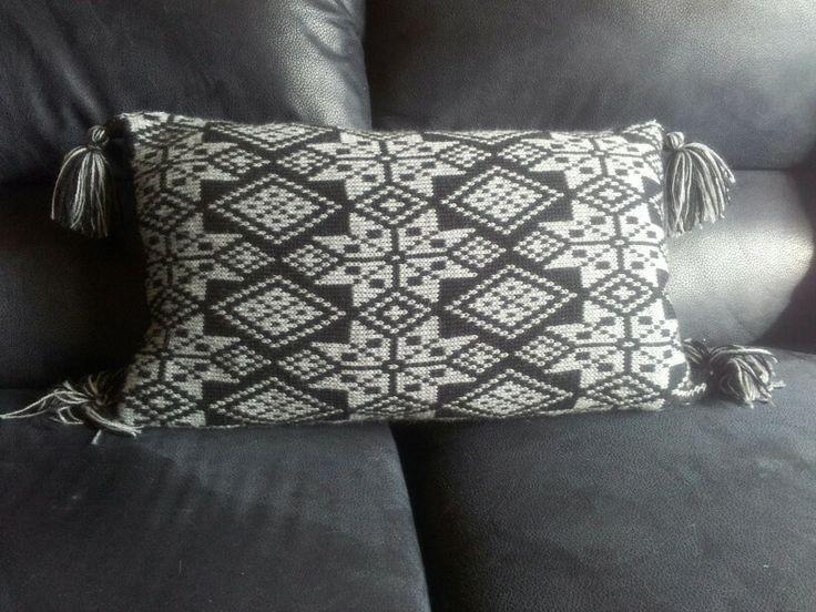 Fair Isle cushion made using acrylic yarn.