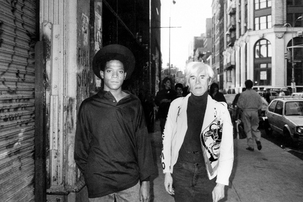 Andy Warhol and Jean-Michel Basquiat on their way to their famous Tony Shafrazi gallery show in Soho in 1985 - from the collection of Ricky Powell photography on view at Klughaus Gallery