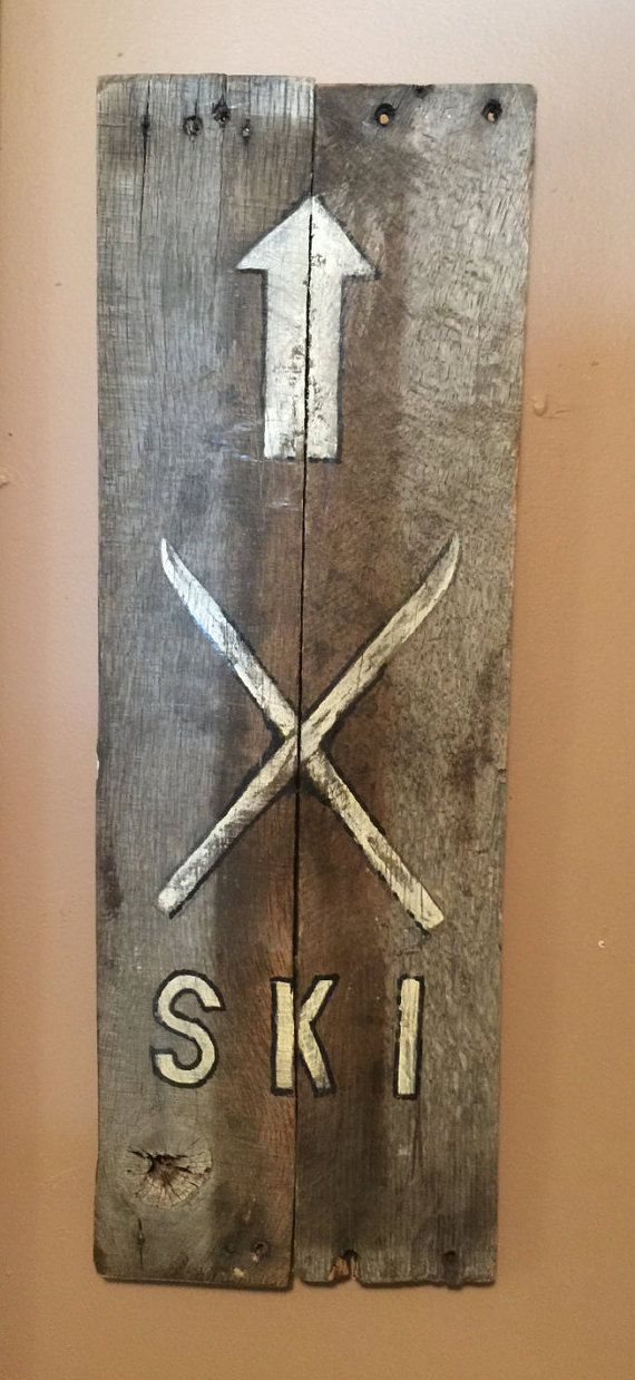 Old Rustic Barn wood sign.' SKI ' with arrow pointing up.