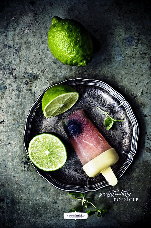 Grapefruit Popsicle :  grapefruit juice  juice and lime zest  sparkling water  teaspoon grated ginger (optional?) honey (about 2 teaspoons, or how much we think)  + in our blackberry and oregano leaves