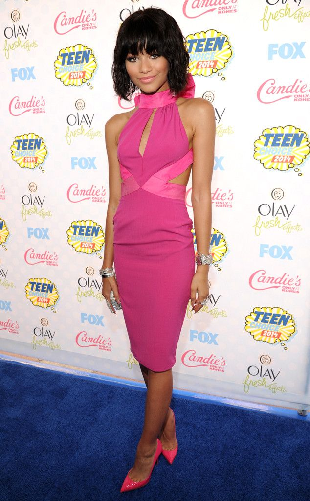 Zendaya rocks head-to-toe highlighter pink with a Material Girl halter dress and Christian Louboutin pumps.