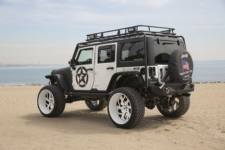 Jeep Wrangler black&white jk full custom lifted white wheels flat top fenders bumper rock guards large cargo basket
