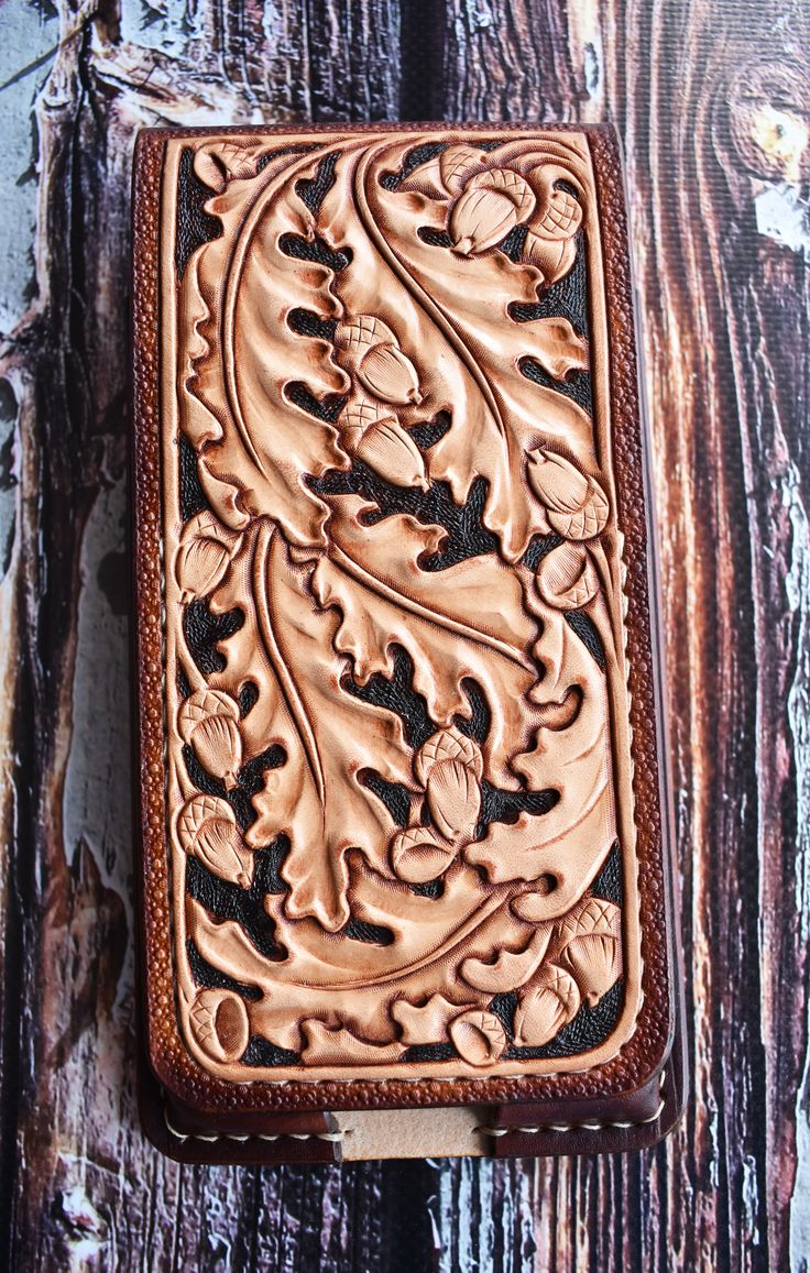 Hand tooled leather phone holster case featuring oak