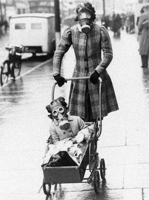 Mother and child wearing their gas masks Southend, 29 March 1941. Photo: Associated Press