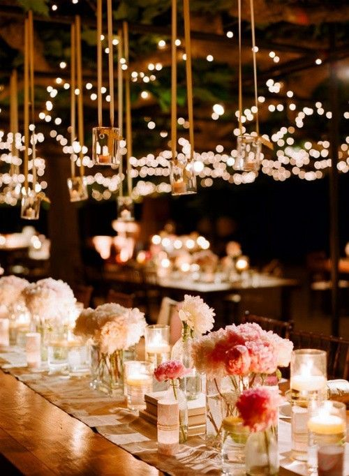 different vases with soft colored flowers and candles randomly placed.: Table Settings, Hanging Lights, Tables Sets, Romantic Wedding, Wedding Ideas, Teas Lights, Fairy Lights, Wedding Reception, Tea Lights