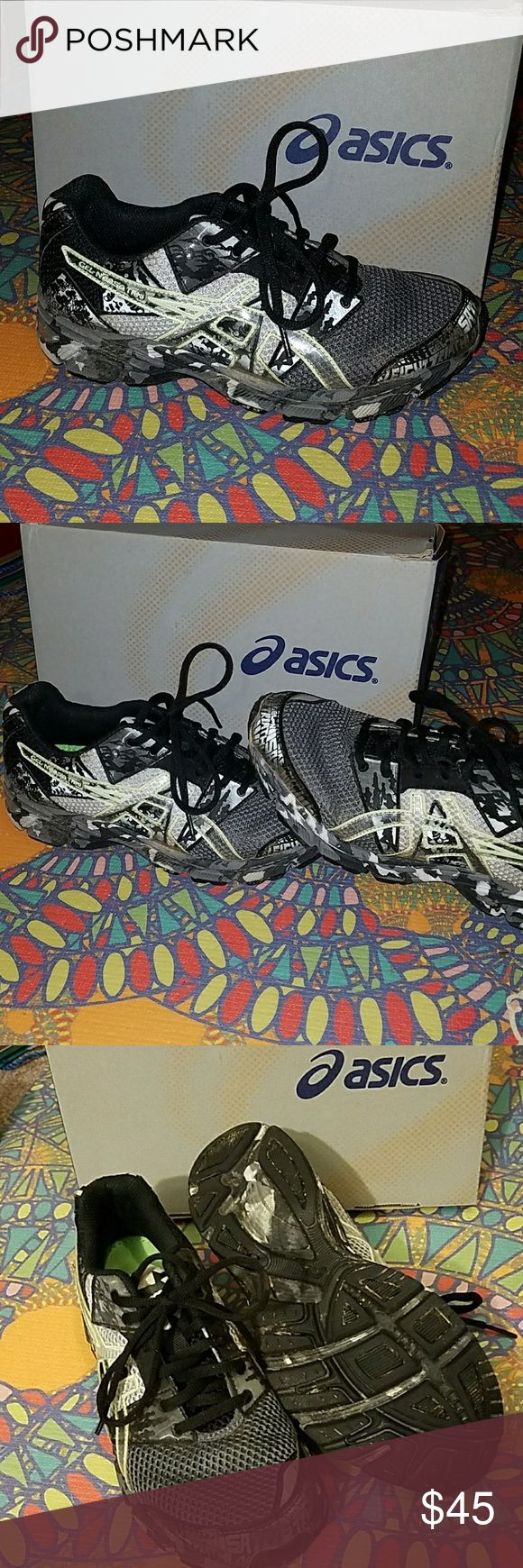 ASICS running shoes Worn once on a trail, so there is a tiny bit of dirt on them but the sole is not compromised. Black and gray shoes with a camo sole. ASICS is a great running brand. 5.5Y fits a womens 7-7.5 comfortably. Asics Noosa is intended to be worn as a marathon shoe. Very supportive and durable.  FEEL FREE TO MAKE AN OFFER! Asics Shoes Sneakers