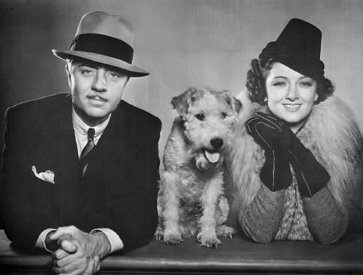 "Nick and Nora (William Powell and Myrna Loy) and their dog Asta from ""The Thin Man"" movies of the 1930s."