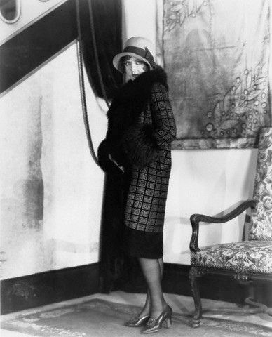 Actress Nancy Carroll Modeling Fashions