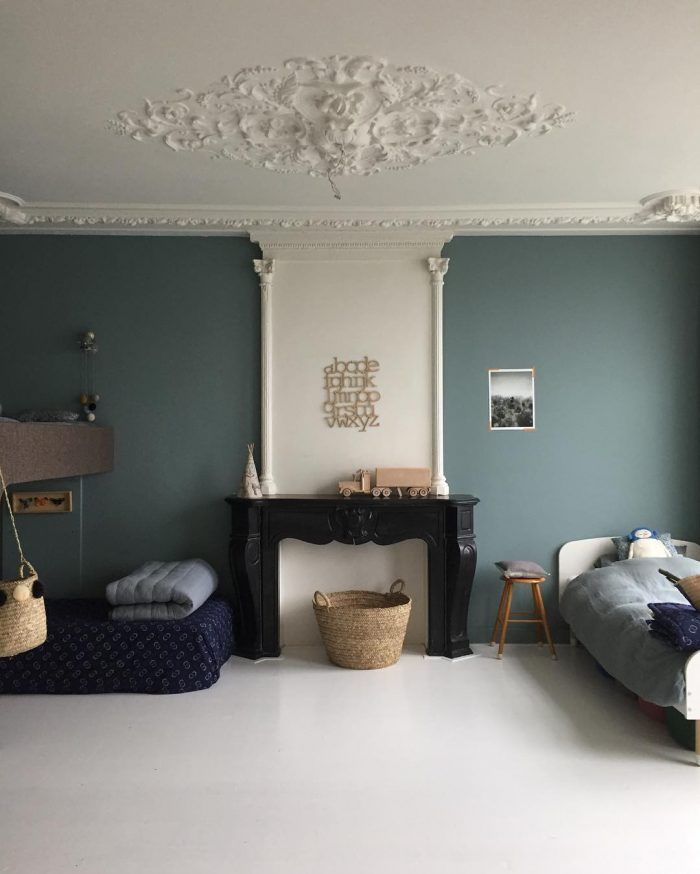 The grey-green walls look stunning but what we can't believe is that this a room shared by three and it's still so minimal and tidy! We're loving the basket details and the odd wooden toys. http://petitandsmall.com/5-stunning-minimal-kids-rooms-warmth/