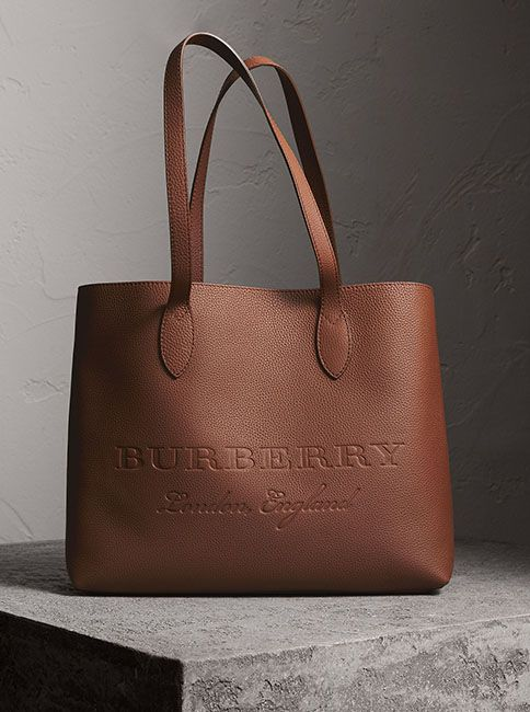 f518a7828704 A versatile tote by Burberry in soft textured calf leather with an interior  zip pocket for small essentials. The minimalist design is finished with  embossed ...