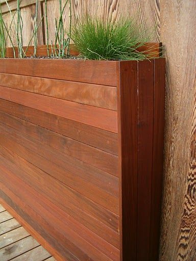 LOVE this narrow planter. Would love to integrate something like this into our privacy fence