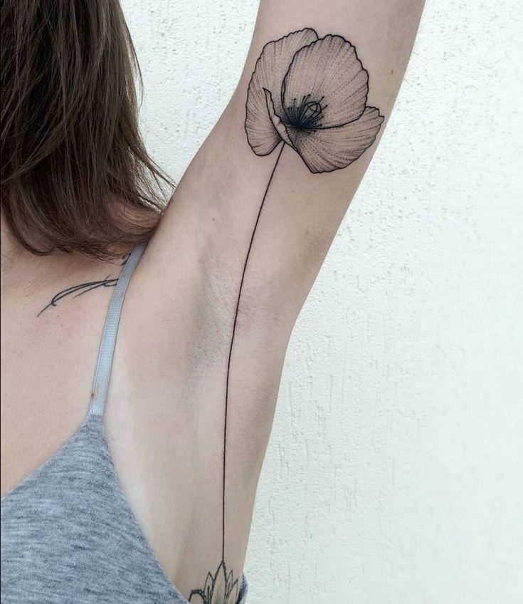 Poppy tattoo on the left armpit.