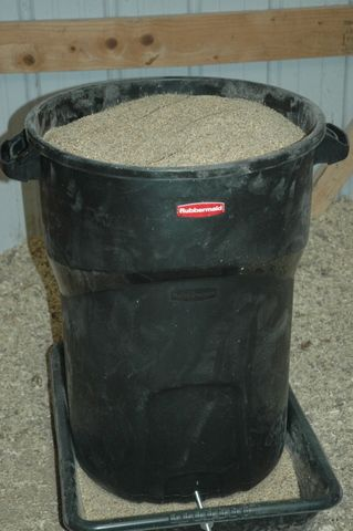 For LARGE quantities of feed-Homemade Chicken Feeder~Perfect if you have to leave town a few days.