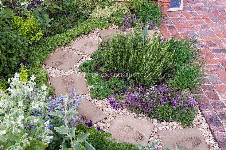 Comfrey brick patio circular stone pathway with footprints inset