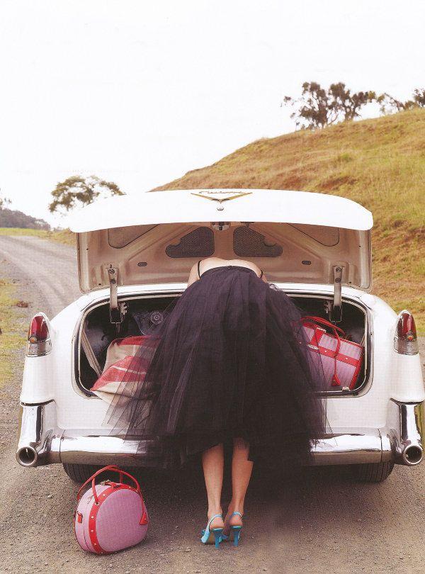 black tulle skirt + pink luggage