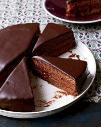 Sacher Torte  Contributed by Lidia Bastianich    Sacher torte is a classic Austrian chocolate cake layered with apricot preserves. Lidia Bastianich's version uses the preserves three ways: for moistening the cake layers, as a thick filling between the layers and as a glaze to seal the cake before covering it in chocolate. The cake is moist and luscious