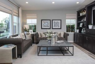 "Transitional Living Room with Delphine Bluestone & Metal 67"" Coffee Table, Carpet, limestone tile floors, High ceiling"