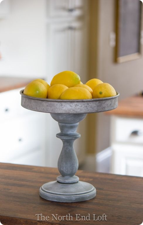 A chunky wood candle holder with a thrift store cake pan make a cute pedestal for the kitchen or for 2-3 candles.