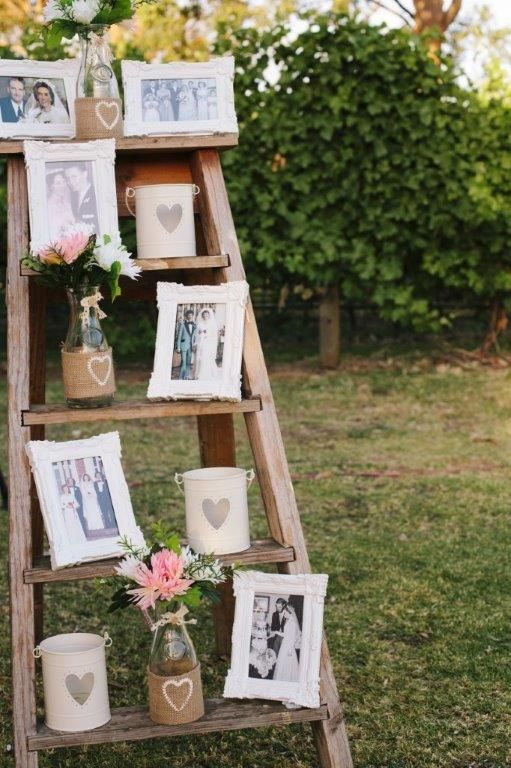Our rustic ladder holding the family photos. www.capeoflove.com
