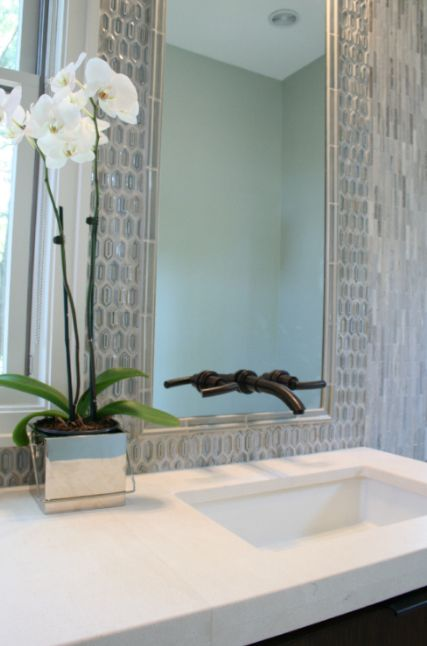 Make Photo Gallery Contemporary bathroom design with espresso stained bathroom cabinet stone counter top oil rubbed bronze wall mount faucet blue glass tiles backsplash