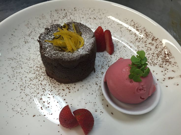 Gooey #Chocolate fondant served with a refreshing Blood orange ice cream from Rydges Sydney Airport.