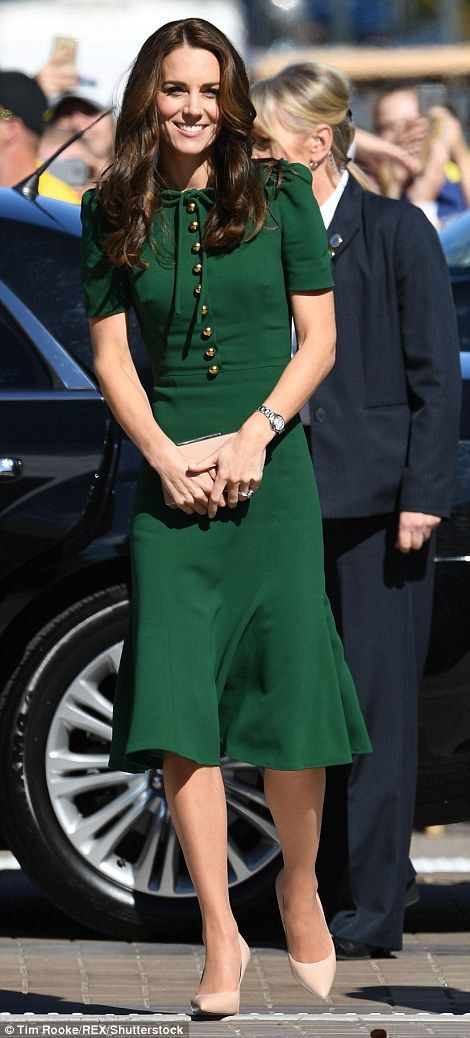 After dressing down in high street jeans and a safari jacket yesterday, Kate upped the style stakes today in a designer dress