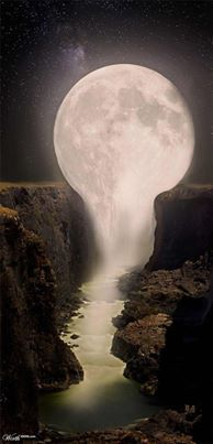 It looks like the moon is sitting on the rocks and then it looks like the moon turns into a river
