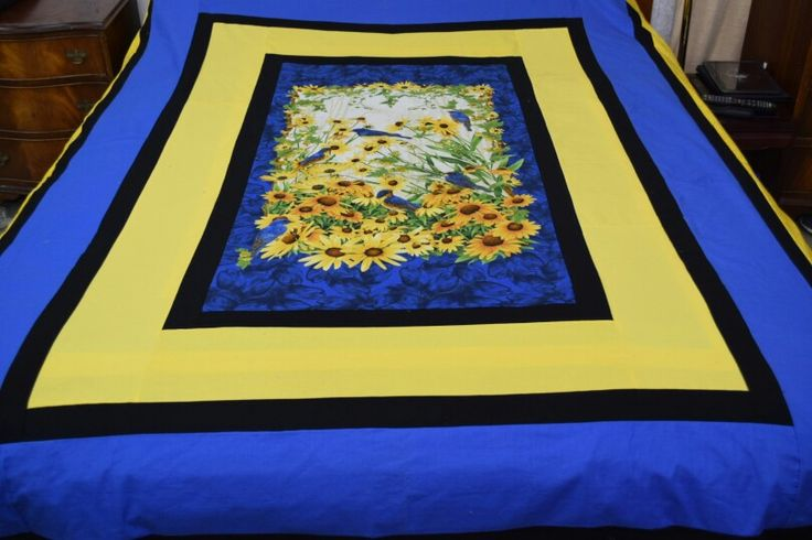 Are you partial to birds and love fresh bright colors that brighten you up well here is the quilt for you . It features bluebirds and daisies It is a queen size bed , and there is only 1  So it is never to be repeated $450, so hurry in quick