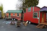 Caravan - The Tiny House Hotel in Portland's Alberta Arts District is opening the doors to four tiny houses, each handcrafted on trailers and available for rent.