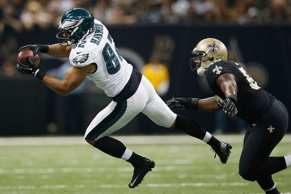 Clay Harbor of Philadelphia makes a catch over Curtis Lofton of New Orleans