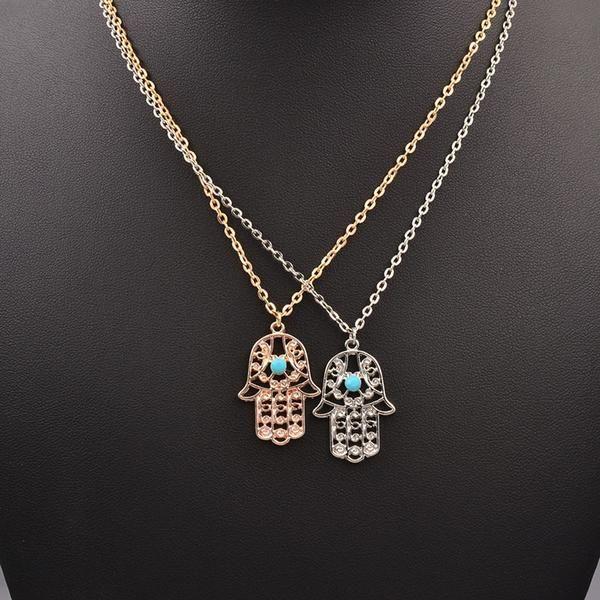 Hand design pendant necklace.