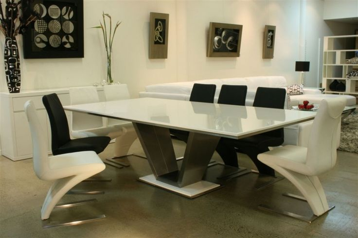 Furniture:Trendy Ultra Modern White Marble Top Dining Table Design Ideas With V Shape Legs Also Minimalist Black And White Chrome Legs Dining Chairs Plus Glass Flower Vase Decor Marble Table Design for Your Choice