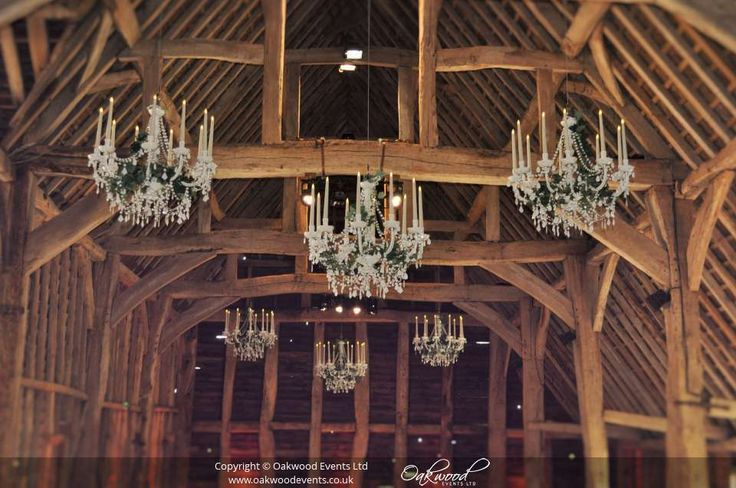Vintage style white chandeliers with silk ivy and LED candles instead of bulbs - for a rustic barn wedding