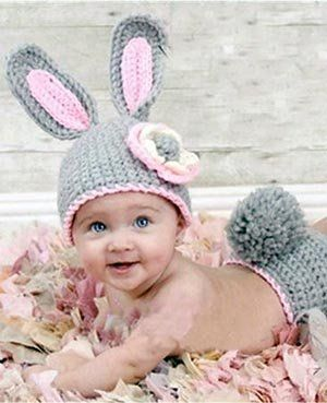 Crochet baby bunny hat with ears and diaper cover with a pom pom bunny tail.  Baby Easter bunny photo prop ideas.