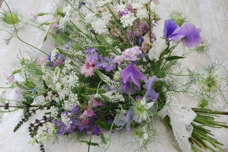 Bridal bouquet with love-in-a-mist, cornflowers, ammi, sweet peas, mint, coriander, veronica and larkspur. www.wildandwondrousflowers.co.uk