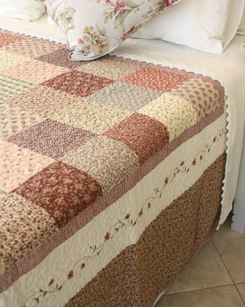 Generously sized quilts suitable for even extra length mattresses. This patchwork quilt features a delicately embroidered border and a scalloped edge.  Available in the following sizes:  Single or 3/4 180x250mm  Double or Queen 230x250mm  Queen or King 260x250mm