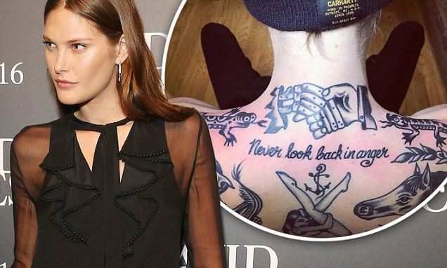 Model Catherine McNeil adds MORE back tattoos to her inked-up body
